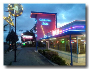 Cadillac Jacks & Pink Motel at night